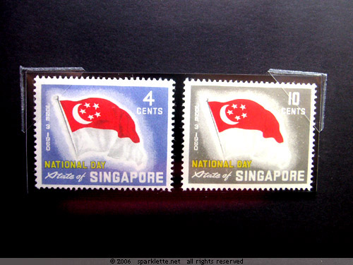The first State of Singapore stamps